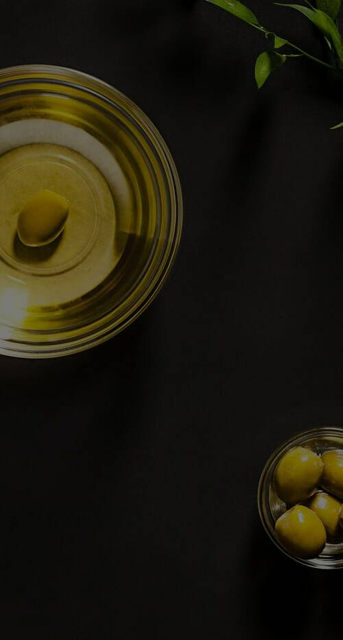 olive-oil-and-olive-branch-on-the-wooden-table-full